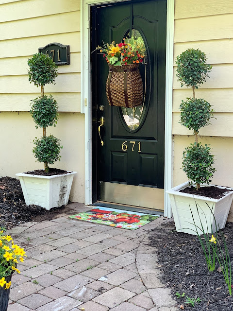 Front door with Ballard designs pack basket and colorful cottage style entryway - www.goldenboysandme.com