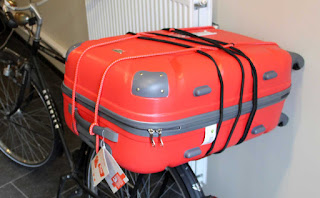 Suitcase strapped to my bike