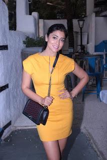 Shriya Saran looks super cute in a very tight small yelow dress at Maria Goreeti Book Launch