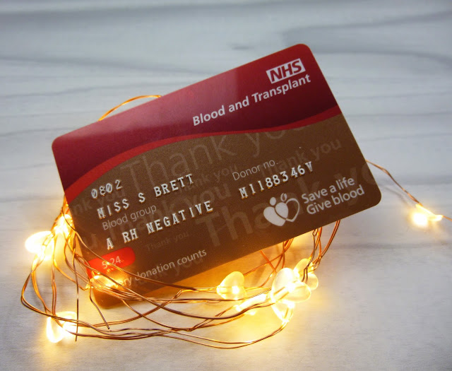 Bronze blood donor card wrapped in copper fairy lights