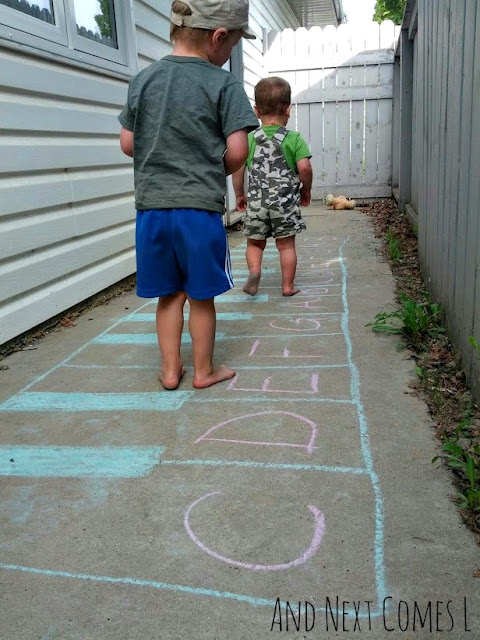 Outdoor music play for kids using a giant chalk keyboard from And Next Comes L
