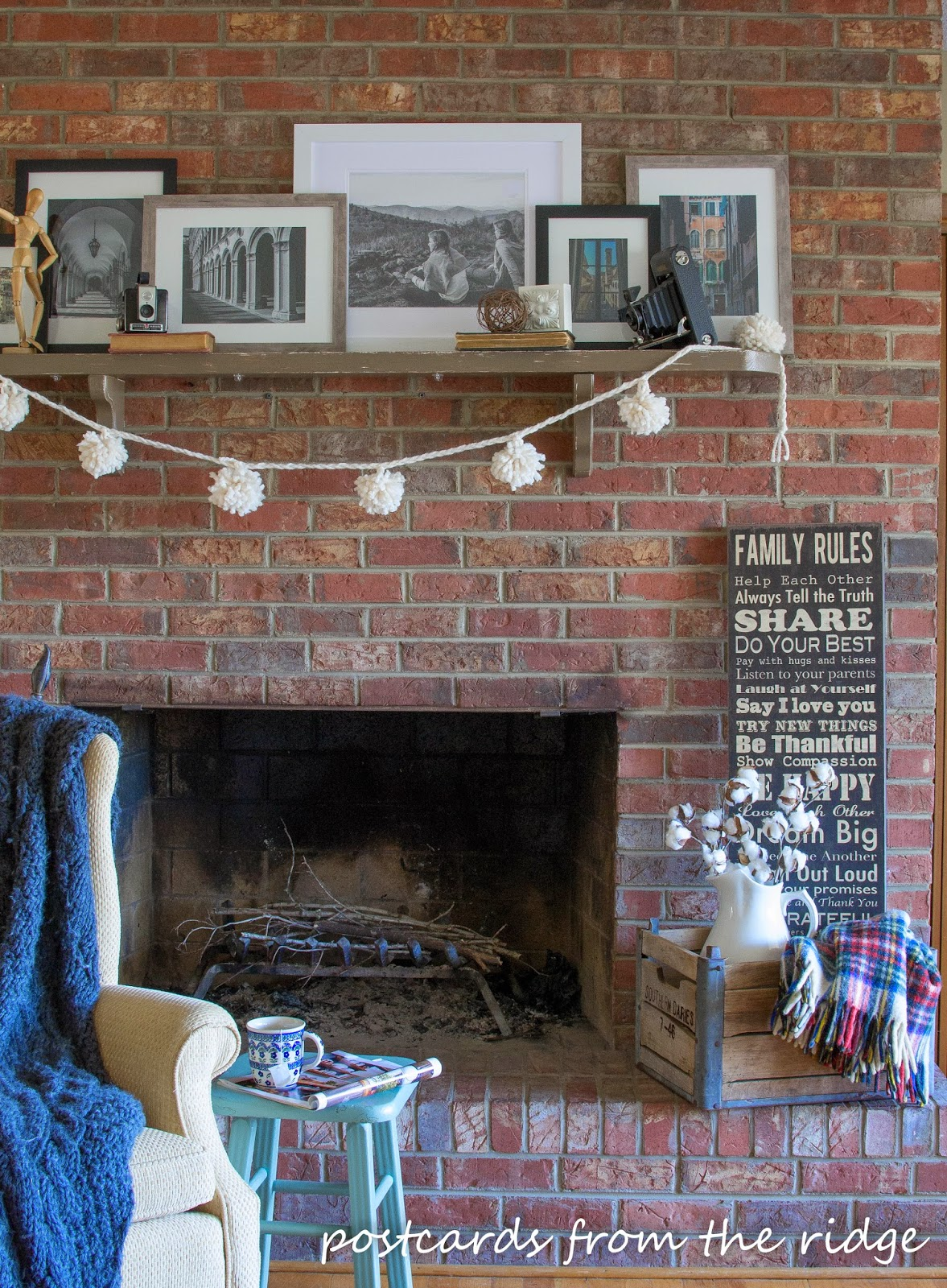 brick fireplace with pom pom garland