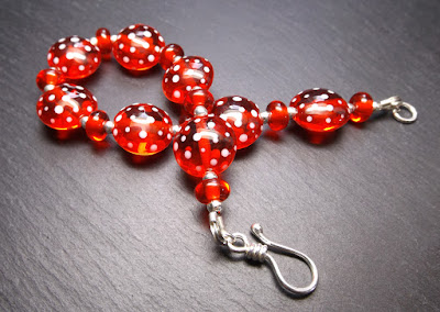 Lampwork glass bead and sterling silver bracelet by Laura Sparling