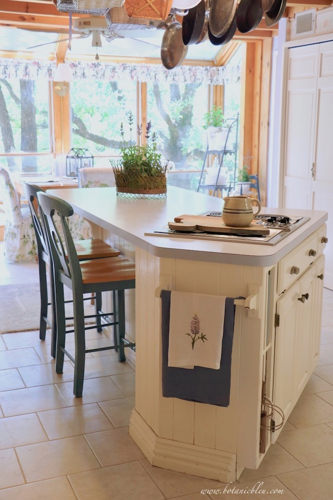 budget wise laminate countertop with six sides in sunspace kitchen