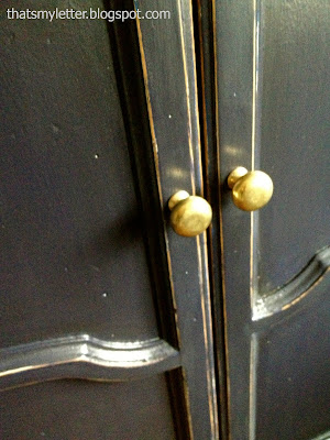 brass knobs on armoire