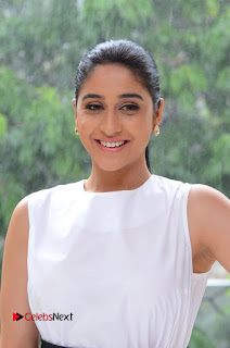 Regina Cassandra in a lovely Tight White Sleeveless Top and Denim Jeans at Jo Achyutananda Interview