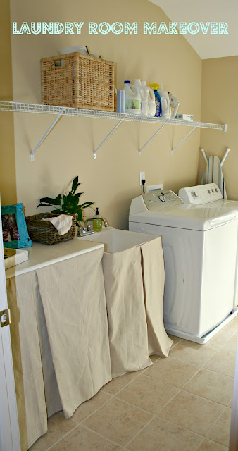 A laundry room with no sew sink and cabinet skirts