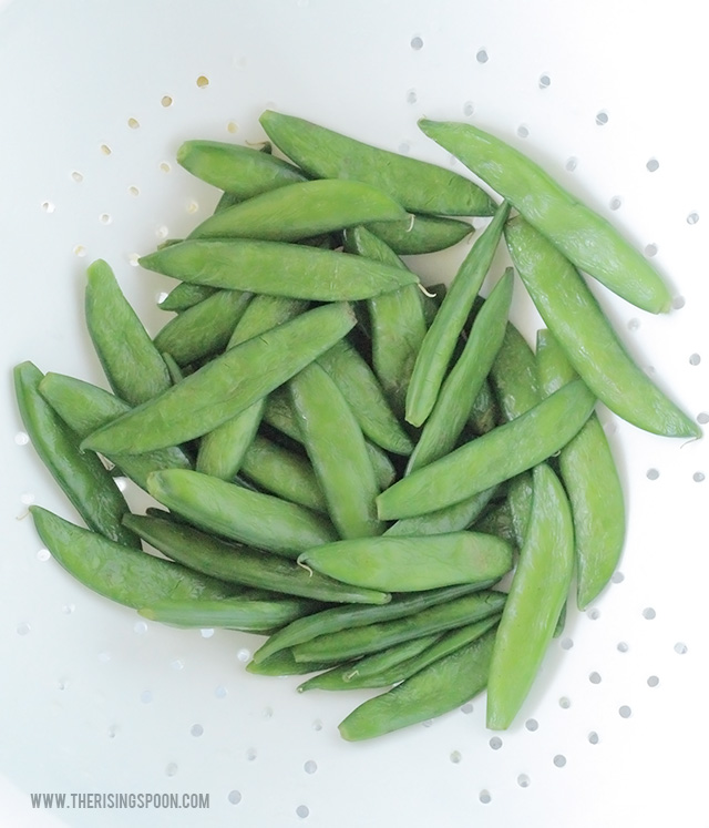 Sugar Snap Peas Thawing in a Colander