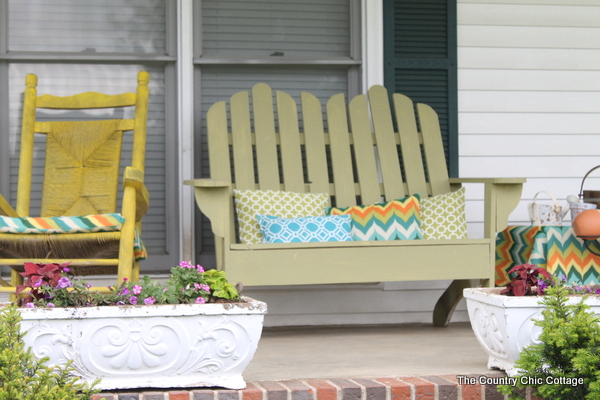 A colorful front porch transformation with a great solar powered fountain -- a must see!