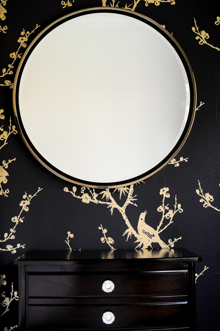 The Wais mirror by Holly & Martin adds a touch of glamour to this dramatic black and gold master bedroom. Simply stunning!