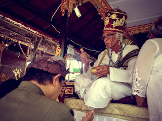 Blessing Is Also Done To The Parents Of The Groom During Balinese Wedding Ceremony At Badung, Bali, Indonesia