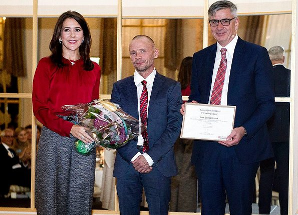 Danish Crown Princess Mary wore Hugo Boss Banora8 blouse and wool trousers at Hotel d'Angleterre in Copenhagen. Danish Heart Association