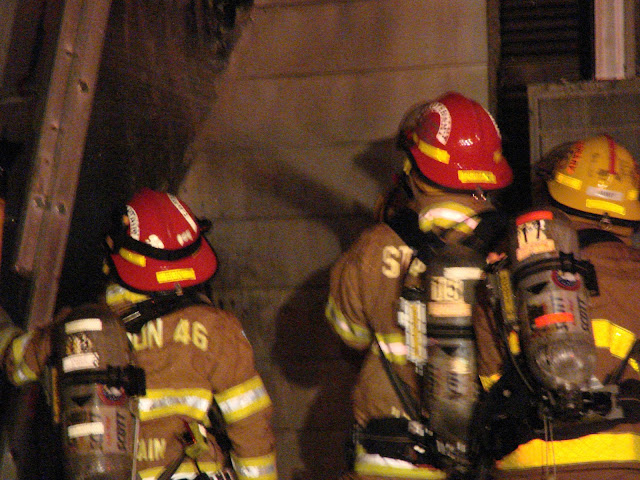 Firefighters On Scene At A Working Structure Fire