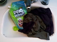 Workout clothes, moisture whicking detergent in sink.