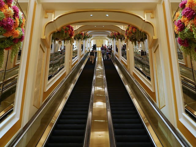 escalators to and from the SkyCab station at Wynn Palace