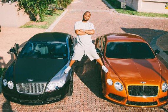 Cassper Nyovest poses on his Bentleys
