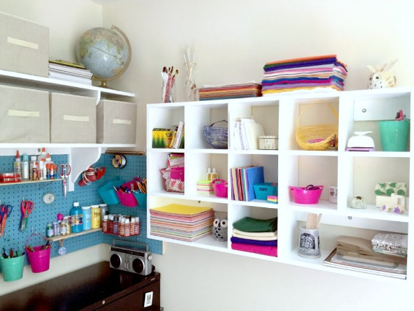 use cubbies and pegboard to organize craft supplies