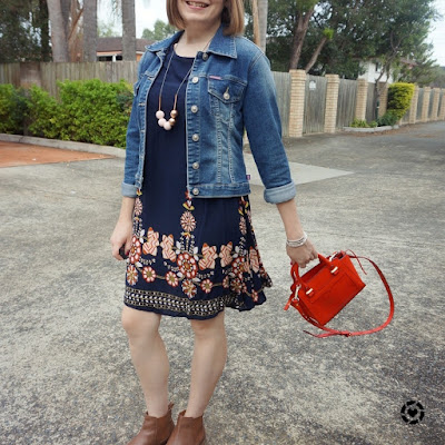 awayfromtheblue Instagram | denim jacket ankle boots floral navy swing dress in autumn red micro avery bag