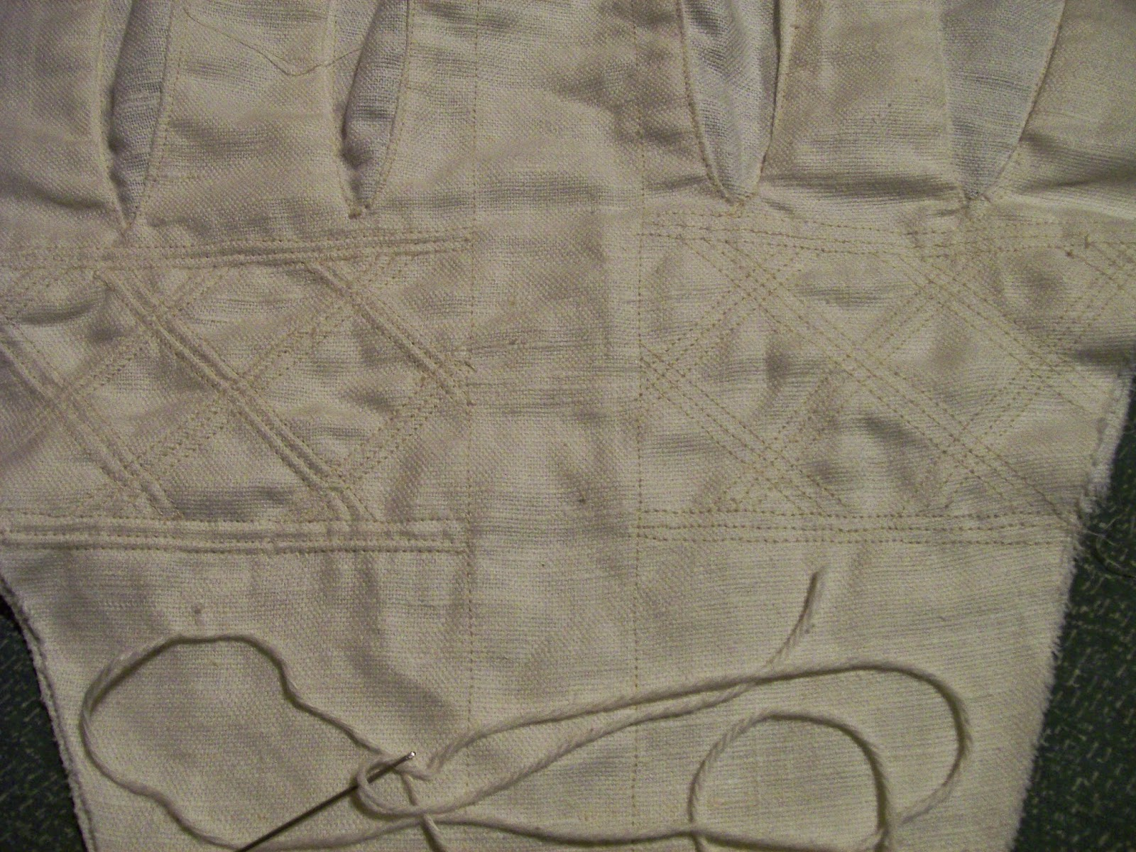 Front panel of stays with one side quilted, and the other quilted and corded.