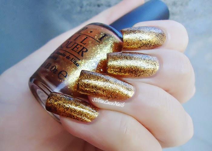 OPI Goldeneye sponging topaz
