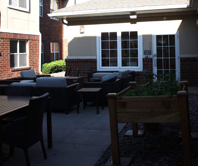 Patio with a grill and herb garden at The Residence Inn Minneapolis-St. Paul/Roseville