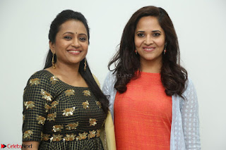 Actress Suma in Black Salwar Suit and Anusuya in orange Dress at winner movie press meet part 1 February 2017 (31).JPG
