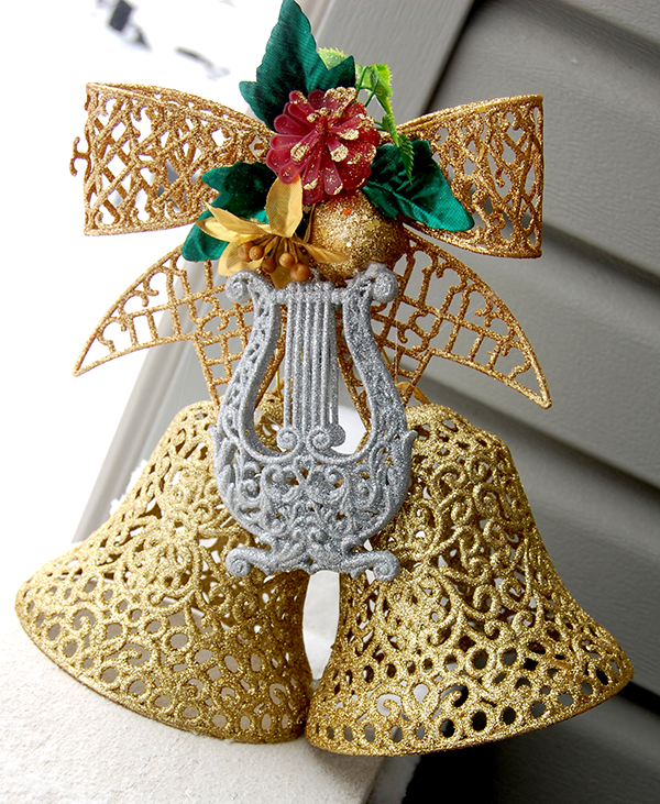 gold ribbon, gold bells and silver harp wall decor