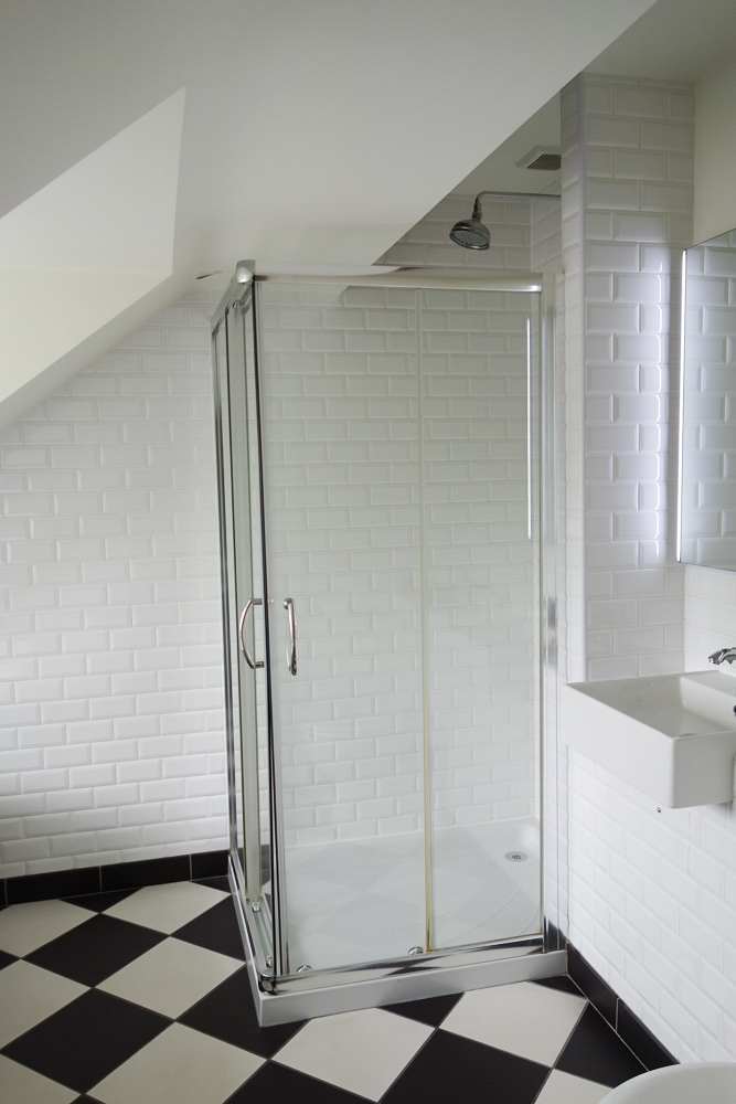 Shower with white tiles