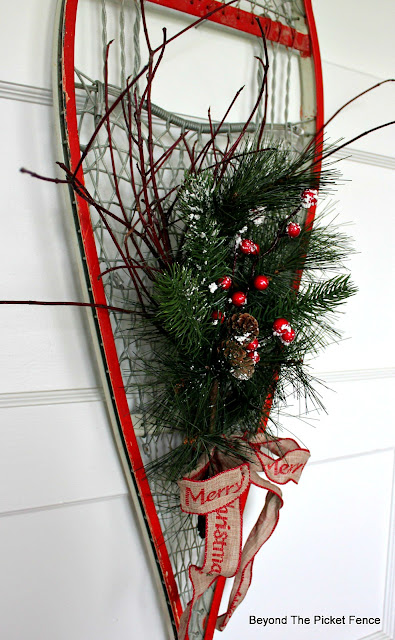 Use Twigs And Pine Garland To Make An Easy Christmas Decoration