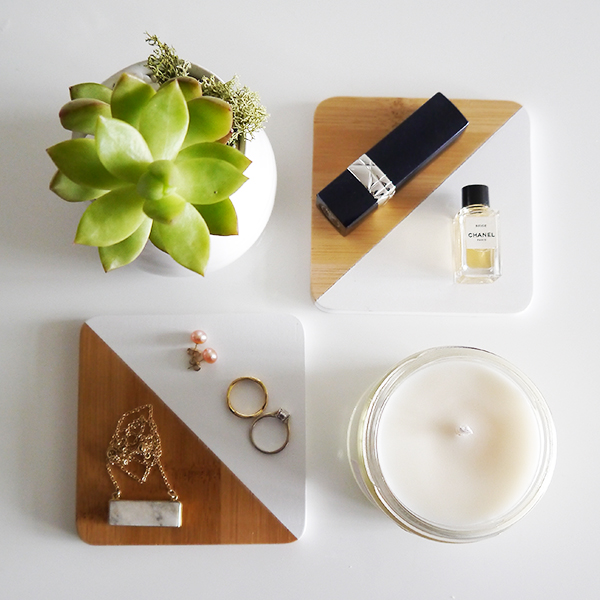 flatlay featuring succulent, Danica minimalist dip-dyed coasters in bamboo and white, pearl stud earrings, white gold diamond engagement ring, De Beers yellow gold infinity half pave wedding band, Dior Rouge lipstick, Chanel Beige perfume