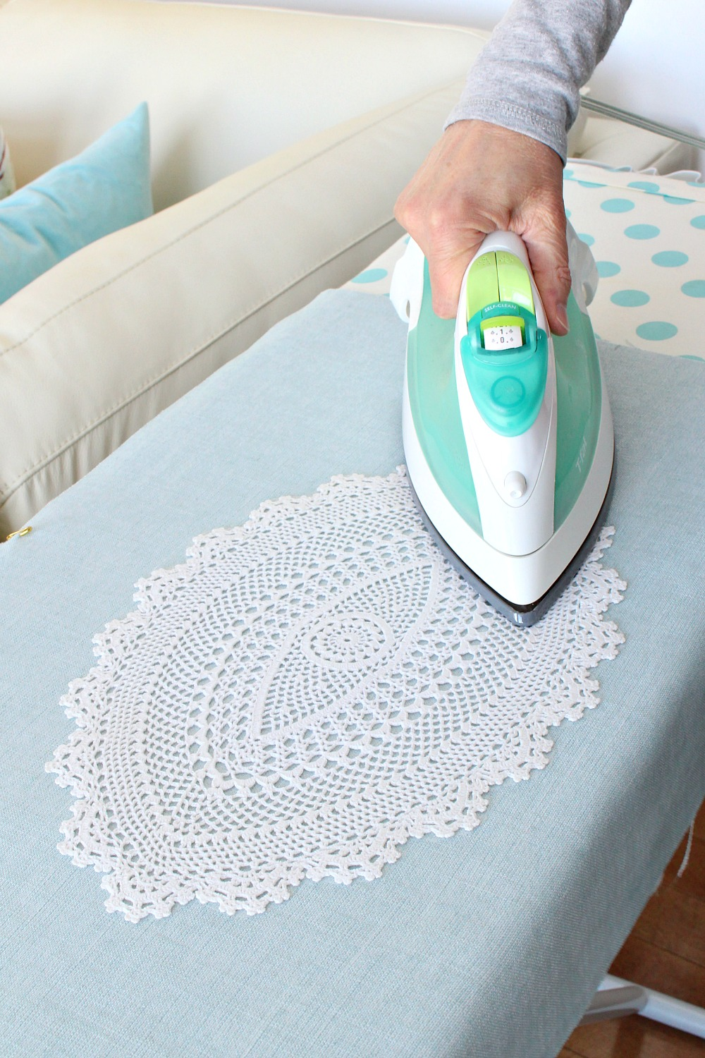 How to glue a doily to fabric