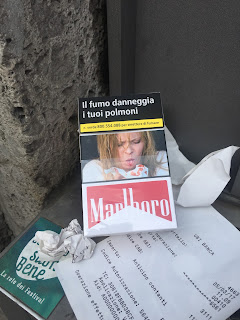 Cigarette box: Coughing up blood.