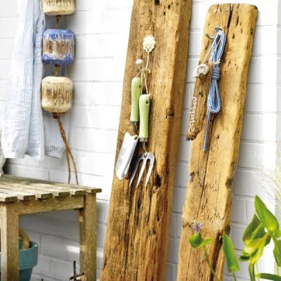driftwood log to hang garden tools