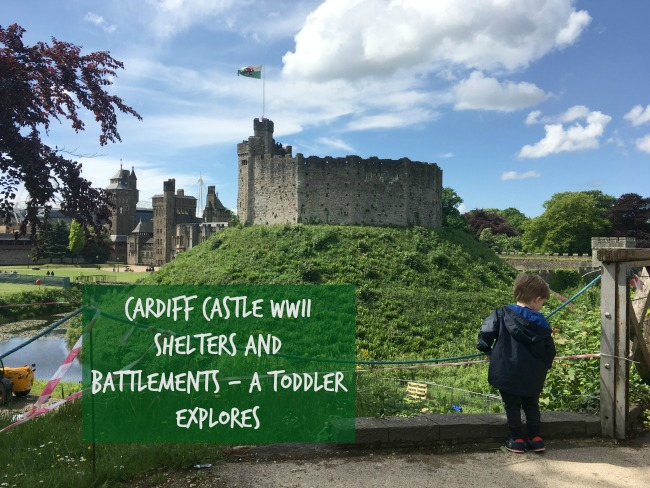 a-toddler-explores-cardiff-castle-world-war-two-shelters-text-over-image-of-toddler-in-front-of-castle-keep