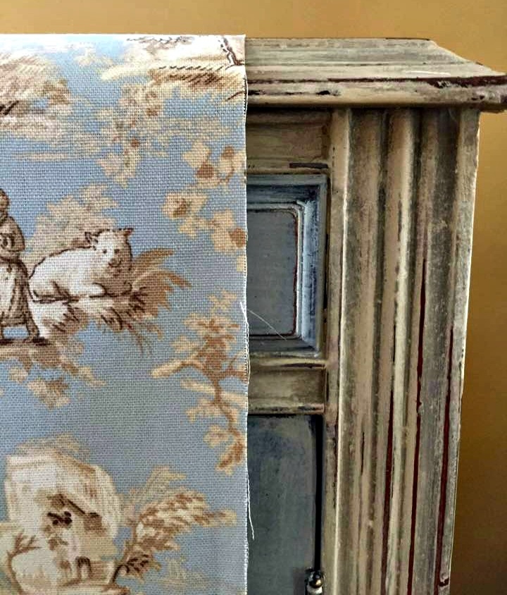 Toile fabric will be used to line the interior of the armoire.