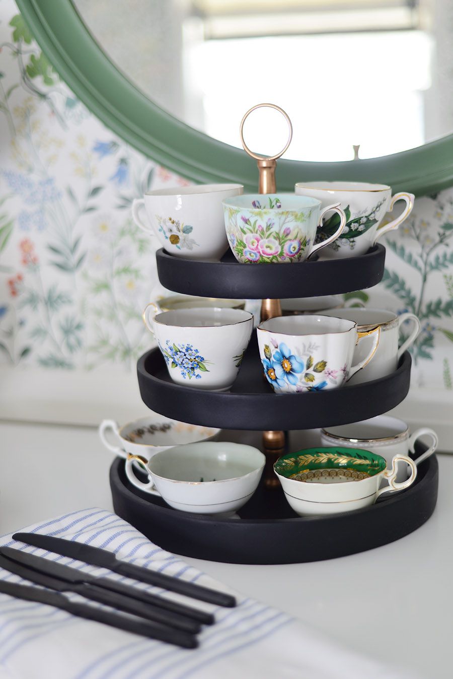Borastapeter flora white wallpaper, green round mirror, buffet display, teacups on tiered tray