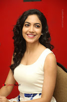 Actress Ritu Varma Stills in White Floral Short Dress at Kesava Movie Success Meet .COM 0175.JPG