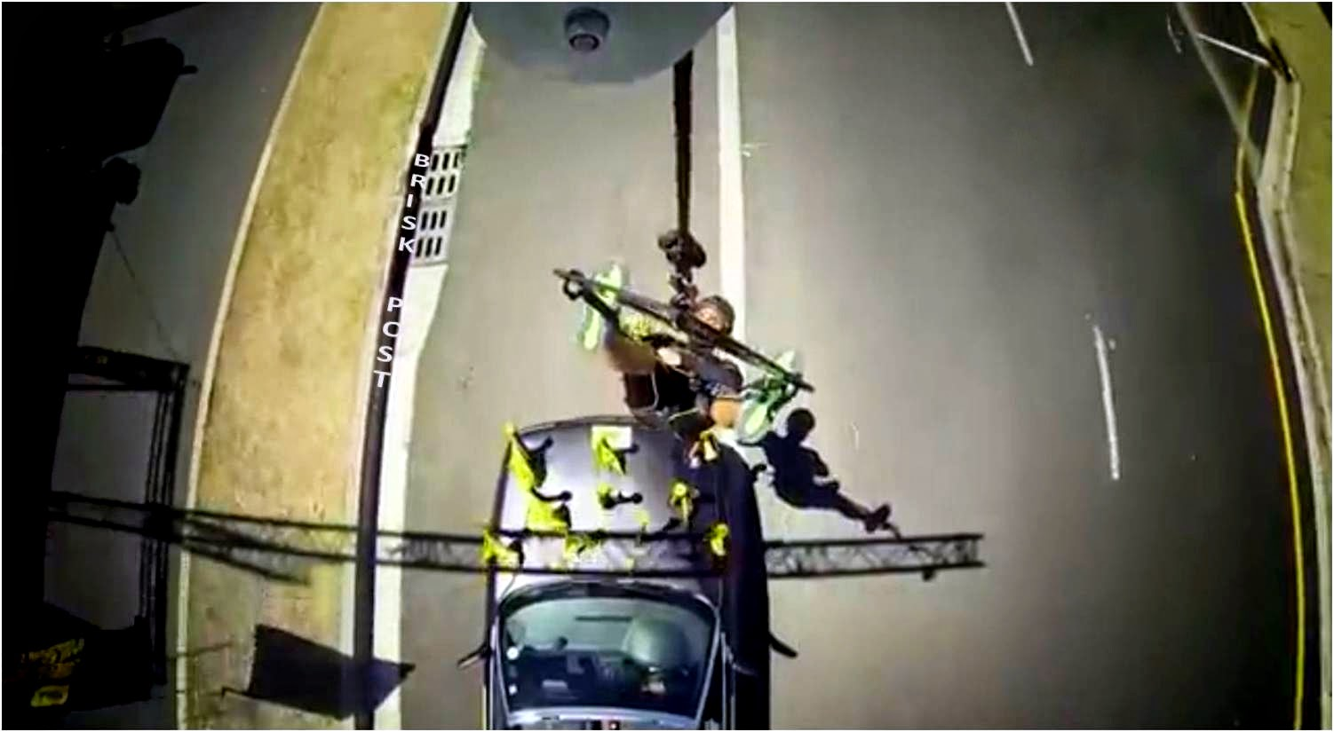 Stunt performer and dance master Salman collecting flags, hanging over a slowly running car