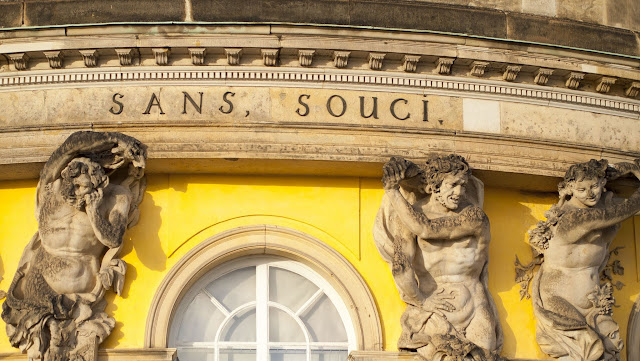 Statues on the facade of Sans Souci palace in Potsdam