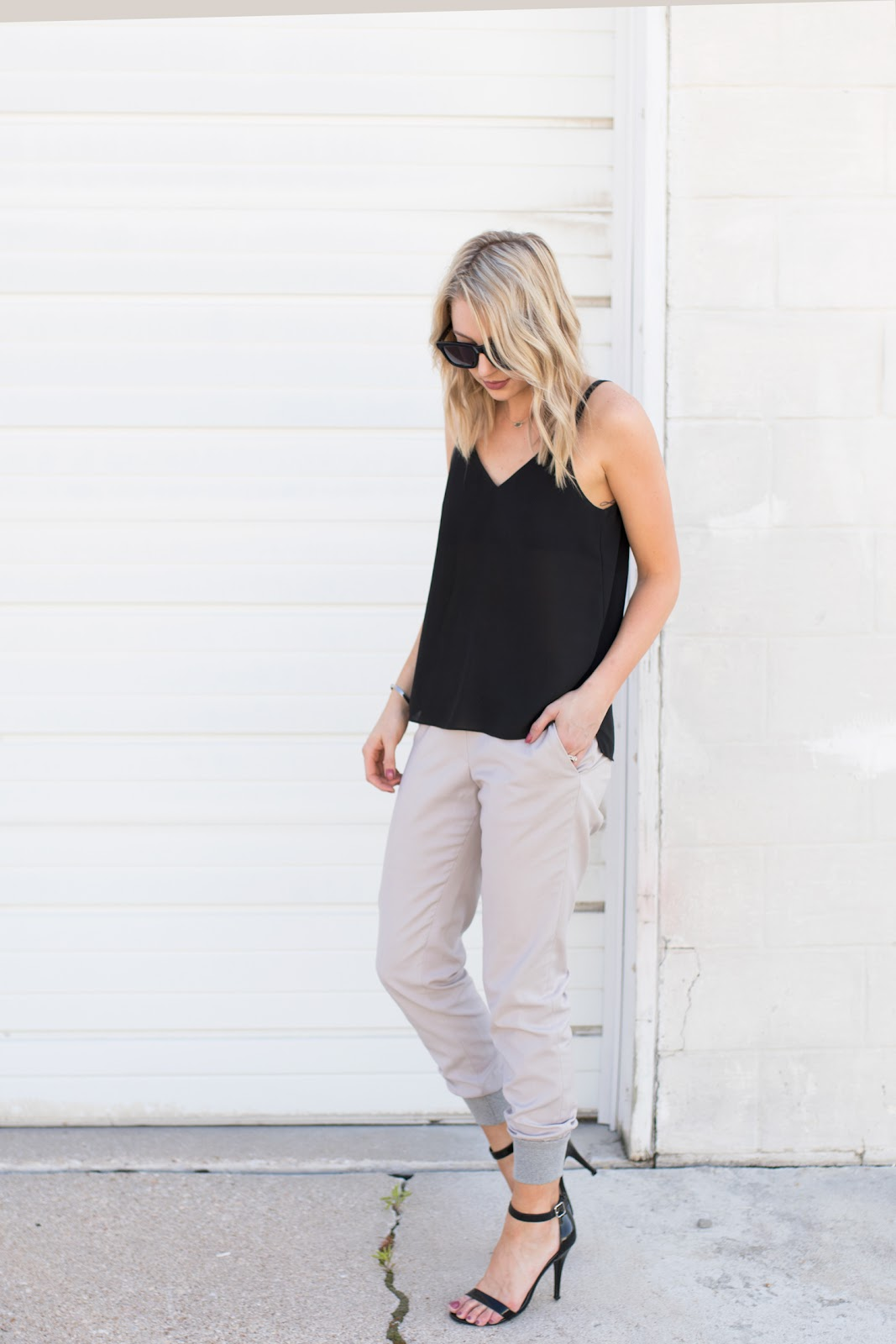 Gray jogger pants with a black tank and heels