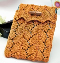 http://www.letsknit.co.uk/free-knitting-patterns/lace-knitted_kindle_cosy