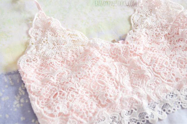 Details on the pastel pink lace bralette crop top from Dresslink.