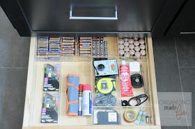 Toekick drawer organized used as junk drawer organizing batteries :: OrganizingMadeFun.com