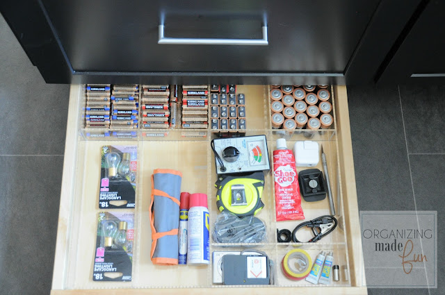 Toekick drawer organized used as junk drawer organizing batteries :: OrganizingMadeFun.com