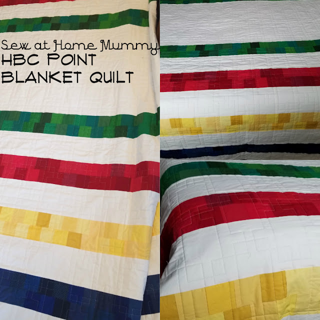 An easy DiY Hudson's Bay Co HBC Point Blanket Quilt featuring traditional pattern front with pixelated stripes, blue single color point blanket backing (making the quilt fully reversible), all pieced with Aurifil thread!