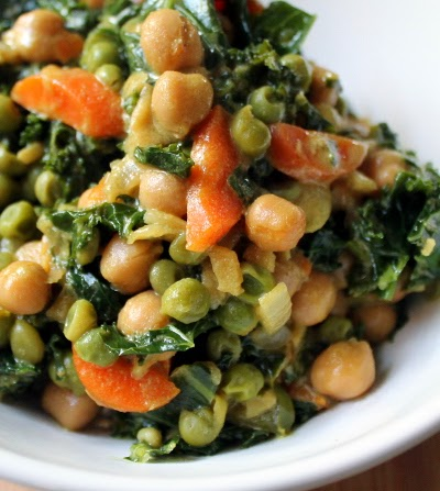 Chickpea coconut milk curry with kale, carrots, and peas