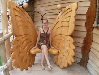 Wooden chair with huge carved butterfly wings and decroative antennae