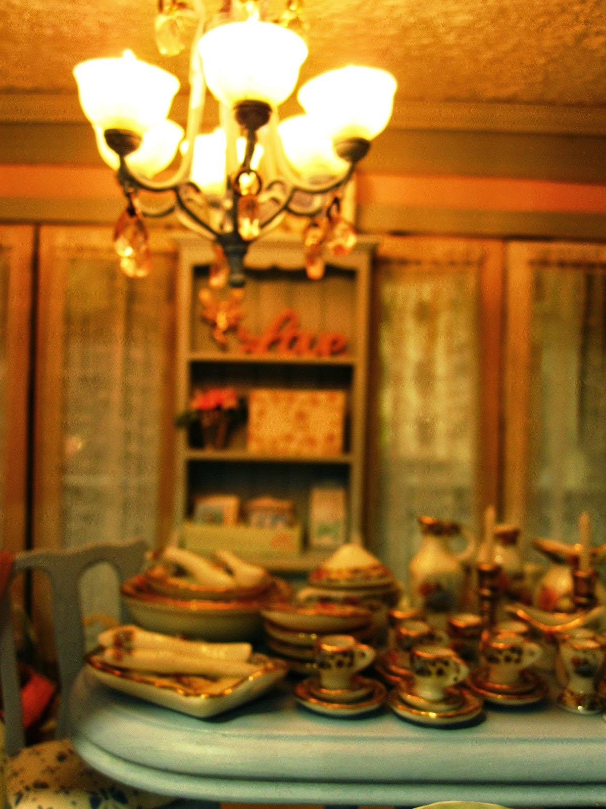 Close-up view of a modern miniature shabby chic shop, showing a dining table displaying a dinner set.