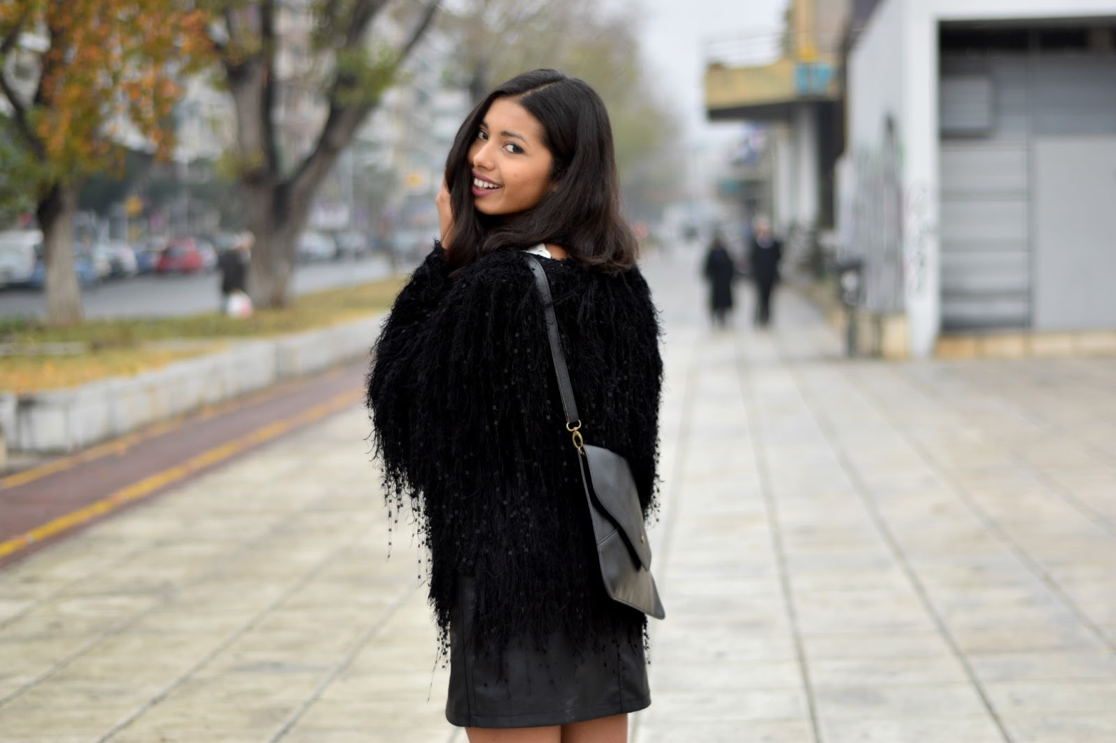 k-meets-style tassel handmade sweater with leather skirt