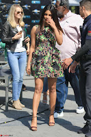 Priyanka Chopra looks super cute in happy mood wearing a short flower print dress in Hollywood 006.jpg